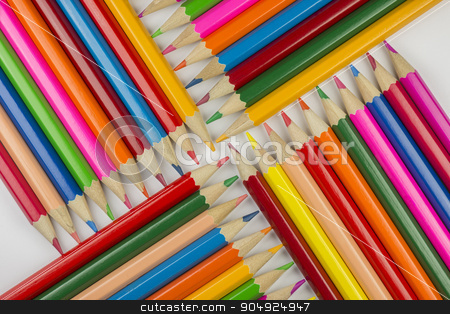 Abstract composition of a set wooden colour pencils stock photo, Abstract composition of a set wooden colour pencils against a white background  by Tofotografie