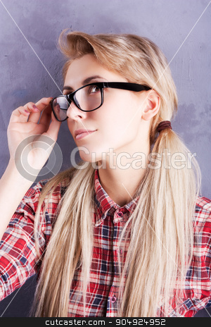 Young beautiful blond woman with glasses stock photo, Student girl in checkered skirt with glasses by sunapple