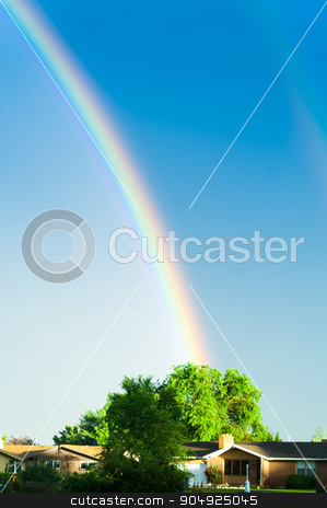 Rainbow 2 is coming through stock photo, Two rainbows filling the sky above a house after a light rain by Daniel Stewart