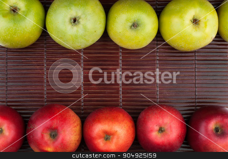 Green and red apples lie on the bamboo mat stock photo, Green and red apples lie on the bamboo mat , with place for your text by alekleks