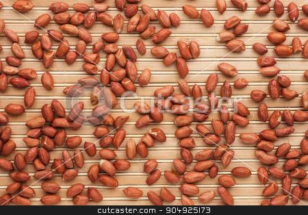 Peanut  lying on a bamboo mat stock photo, Peanut  lying on a bamboo mat, can be used as background by alekleks
