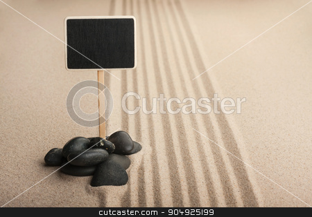 Pointer board standing  in the stones on the sand stock photo, Pointer board standing  in the stones on the sand, with place for your text by alekleks