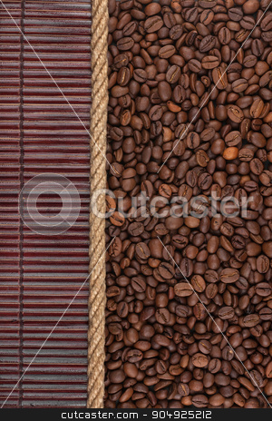 Coffee beans  lying on dark bamboo mat, for menu stock photo, Coffee beans  lying on dark bamboo mat, for menu, can be used as background by alekleks