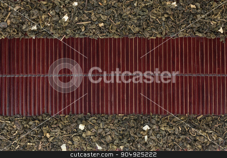 Dried  green tea  on a dark  bamboo mat stock photo, Dried  green tea  on a dark  bamboo mat, with space for text by alekleks