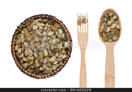 Pumpkin seed in a plate, fork and spoon stock photo,   Pumpkin seed in a plate, fork and spoon, isolated on white background by alekleks