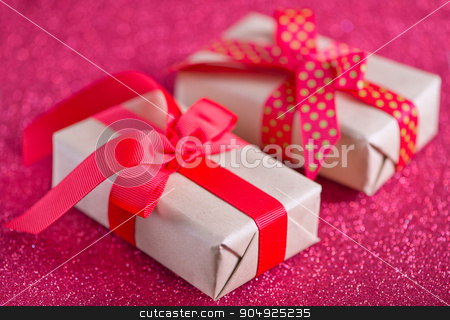 presents stock photo, box for present with red ribbon on the wooden table by tycoon