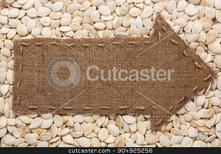 Pointer of  burlap lies on sunflower seeds stock photo, Pointer of  burlap lies on sunflower seeds, with place for your text by alekleks