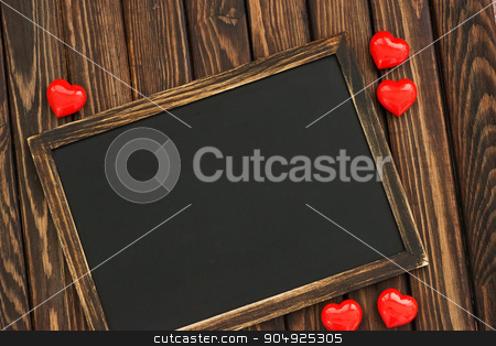 hearts and blackboard  stock photo, hearts and blackboard on the wooden background by tycoon