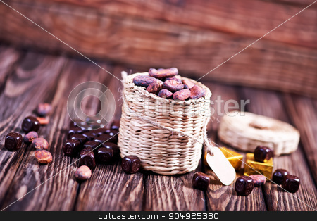 cocoa beans stock photo, cocoa  on the wooden table, cocoa beans by tycoon