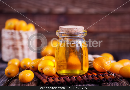 kumqwat oil  stock photo, kumqwat oil in bank and on the wooden table by tycoon