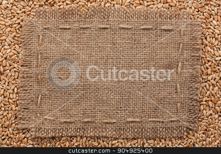Frame of burlap  lying on a wheat  background stock photo, Frame of burlap  lying on a wheat  background, with place for your text by alekleks