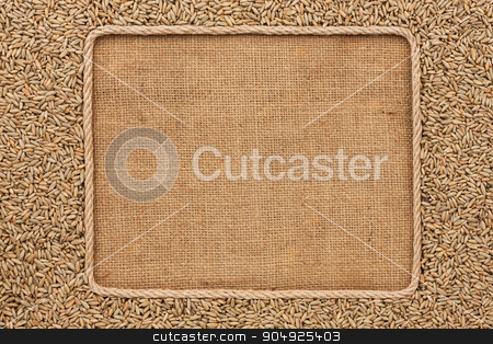 Frame made of rope with rye grains on sackcloth stock photo, Frame made of rope with rye grains on sackcloth, with place for your creativity by alekleks