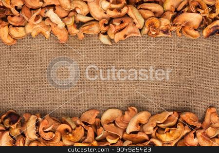 dried apple  were lying on sackcloth stock photo, dried apple  were lying on sackcloth, with space for text by alekleks
