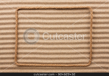 Frame made of rope  on the sand stock photo, Frame made of rope  on the sand, with place for your text by alekleks