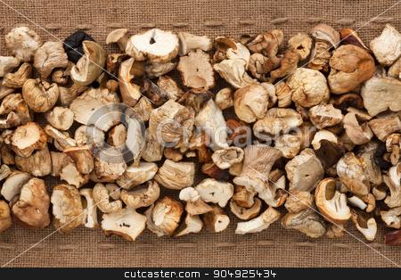 Dried  boletus  lying on sackcloth between the lines stock photo, Dried  boletus  lying on sackcloth between the lines, can be used as background by alekleks