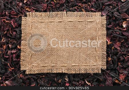 Frame made of burlap with the line lies on  hibiscus stock photo, Frame made of burlap with the line lies on  hibiscus, with place for your text by alekleks