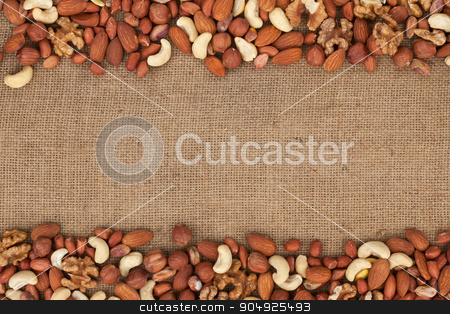 Mixture of nuts lying on sackcloth  stock photo, Mixture of nuts lying on sackcloth with space for text by alekleks