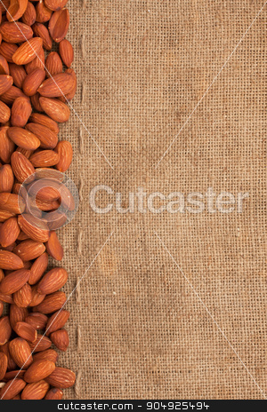 Almond lying on burlap  stock photo, Almond lying on burlap can be used as background by alekleks
