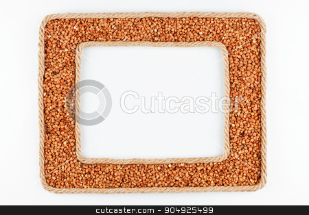 Two frames made of the rope with buckwheat  grain on a white bac stock photo, Two frames made of the rope with buckwheat  grain on a white background, with place for your text by alekleks
