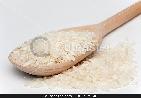 rice with a wooden spoon  stock photo, rice with a wooden spoon on a white background by alekleks