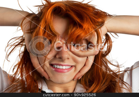 Red-haired girl makes out of its hands symbolic glasses stock photo, Red-haired girl makes out of its hands symbolic glasses, isolated on white background by alekleks