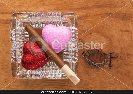 Love and harmful habit in a glass ashtray stock photo, Love and harmful habit in a glass ashtray, conceptual image by alekleks