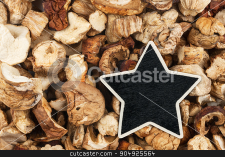Star, pointer, price, tag, lies on dried mushrooms stock photo, Star, pointer, price, tag, lies on dried mushrooms,  with space for your text by alekleks