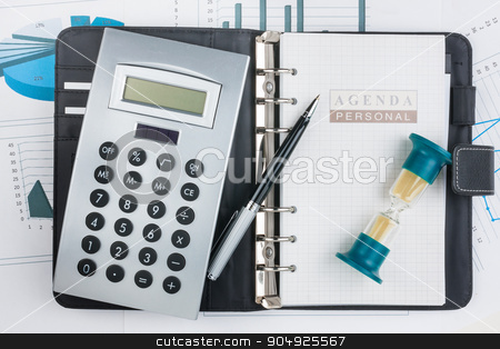 Diary, calculator,hourglass and pen  stock photo, Diary, calculator,hourglass and pen lying on a background of diagrams and graphs  by alekleks