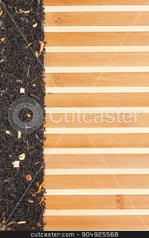 Dried  black  tea  on a bamboo mat stock photo, Dried  black  tea  on a bamboo mat, with space for text, for menu by alekleks