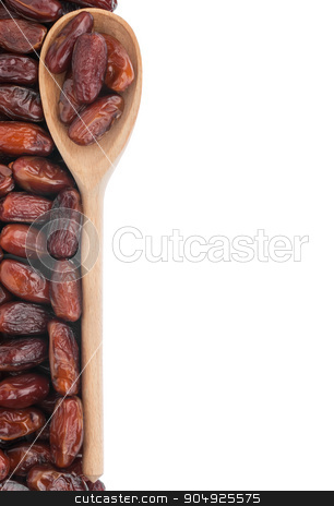 Wooden spoon with dates stock photo, Wooden spoon with dates, isolated on white background by alekleks