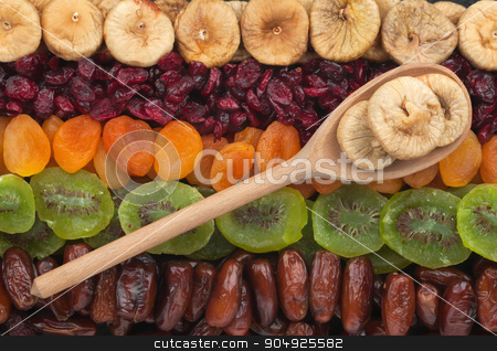 Wooden spoon with figs  stock photo, Wooden spoon with figs lies on the dried fruit by alekleks