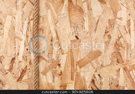 Rope lying on oriented strand board stock photo, Rope lying on oriented strand board, with space for your text by alekleks