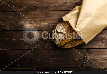 Homemade bread on wood board stock photo, Homemade bread, place for your advertisement, dark picture by Peteer