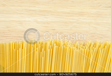 Raw spaghetti on wooden. stock photo, Raw spaghetti on wooden background. by Miss. PENCHAN  PUMILA