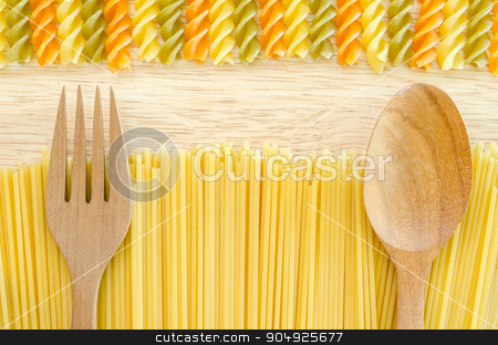 Italian raw pasta with uncooked pasta spaghetti macaroni. stock photo, Italian raw pasta with uncooked pasta spaghetti macaroni on wooden background. by Miss. PENCHAN  PUMILA