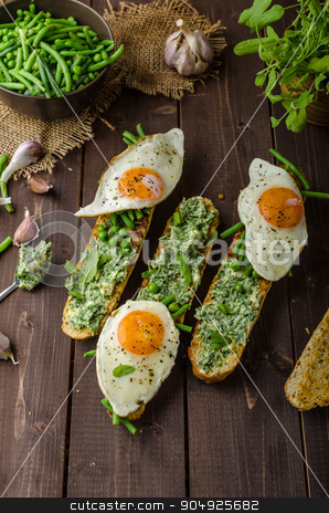 Baguette with herb butter stock photo, Healthy rustic baguette with herb butter and vegetables by Peteer