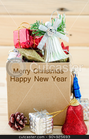 Christmas decoration in box with Merry Christmas and Happy New Y stock photo, Christmas decoration in box with Merry Christmas and Happy New Year text on wooden background. by Miss. PENCHAN  PUMILA