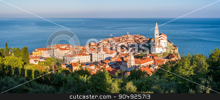 Sunlit Old Town of Piran in the Morning. stock photo, Panoramic View of Picturesque Piran Old Town in Slovenia in the Morning. Aerial view. by Karol Czinege