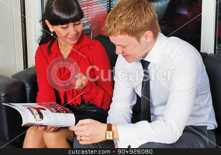 Businessman in car shop communicate with woman stock photo, Businesswoman in car sale office talks with manager by Aikon