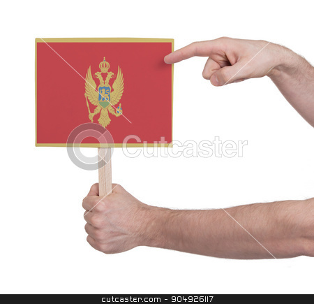 Hand holding small card - Flag of Montenegro stock photo, Hand holding small card, isolated on white - Flag of Montenegro by michaklootwijk