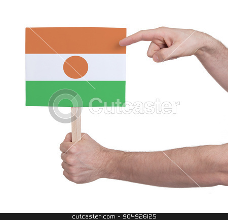 Hand holding small card - Flag of Niger stock photo, Hand holding small card, isolated on white - Flag of Niger by michaklootwijk