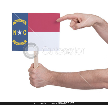 Hand holding small card - Flag of North Carolina stock photo, Hand holding small card, isolated on white - Flag of North Carolina by michaklootwijk