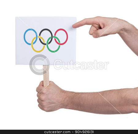 Hand holding small card - Flag of the Olympic games stock photo, Hand holding small card, isolated on white - Flag of the Olympic games by michaklootwijk
