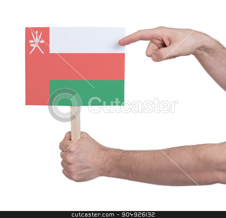 Hand holding small card - Flag of Oman stock photo, Hand holding small card, isolated on white - Flag of Oman by michaklootwijk