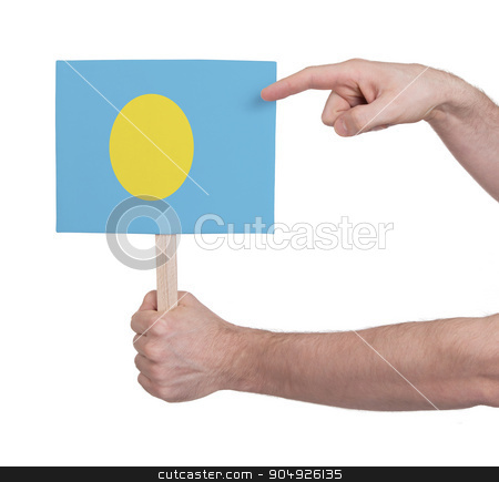 Hand holding small card - Flag of Palau stock photo, Hand holding small card, isolated on white - Flag of Palau by michaklootwijk