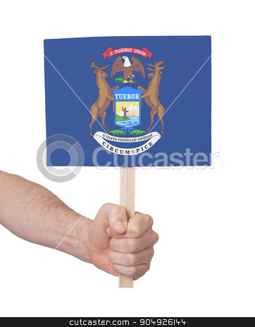 Hand holding small card - Flag of Michigan stock photo, Hand holding small card, isolated on white - Flag of Michigan by michaklootwijk