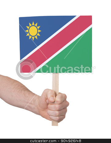 Hand holding small card - Flag of Namibia stock photo, Hand holding small card, isolated on white - Flag of Namibia by michaklootwijk