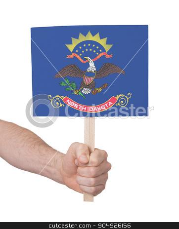Hand holding small card - Flag of North Dakota stock photo, Hand holding small card, isolated on white - Flag of North Dakota by michaklootwijk