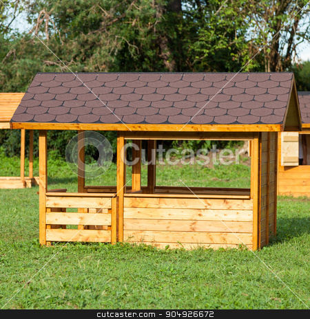 Children houses stock photo, Small children houses made of wood in an Italian park by Paolo Gallo