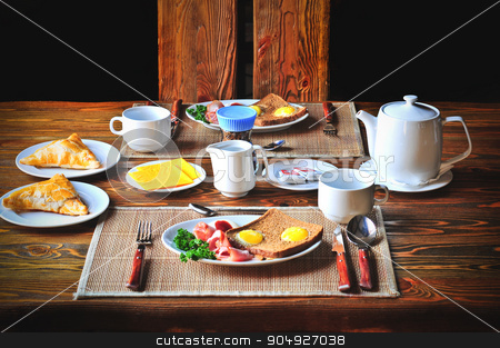 Traditional breakfast set for two persons on the wooden table. stock photo, Traditional breakfast set for two persons on a wooden table. by agnormark